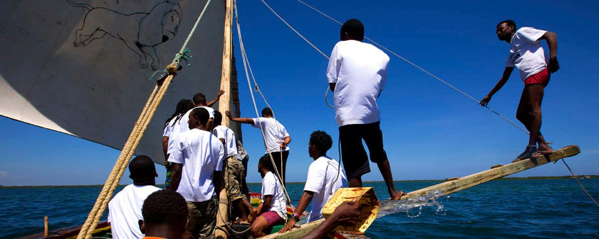 The crew of a dhow at sea.