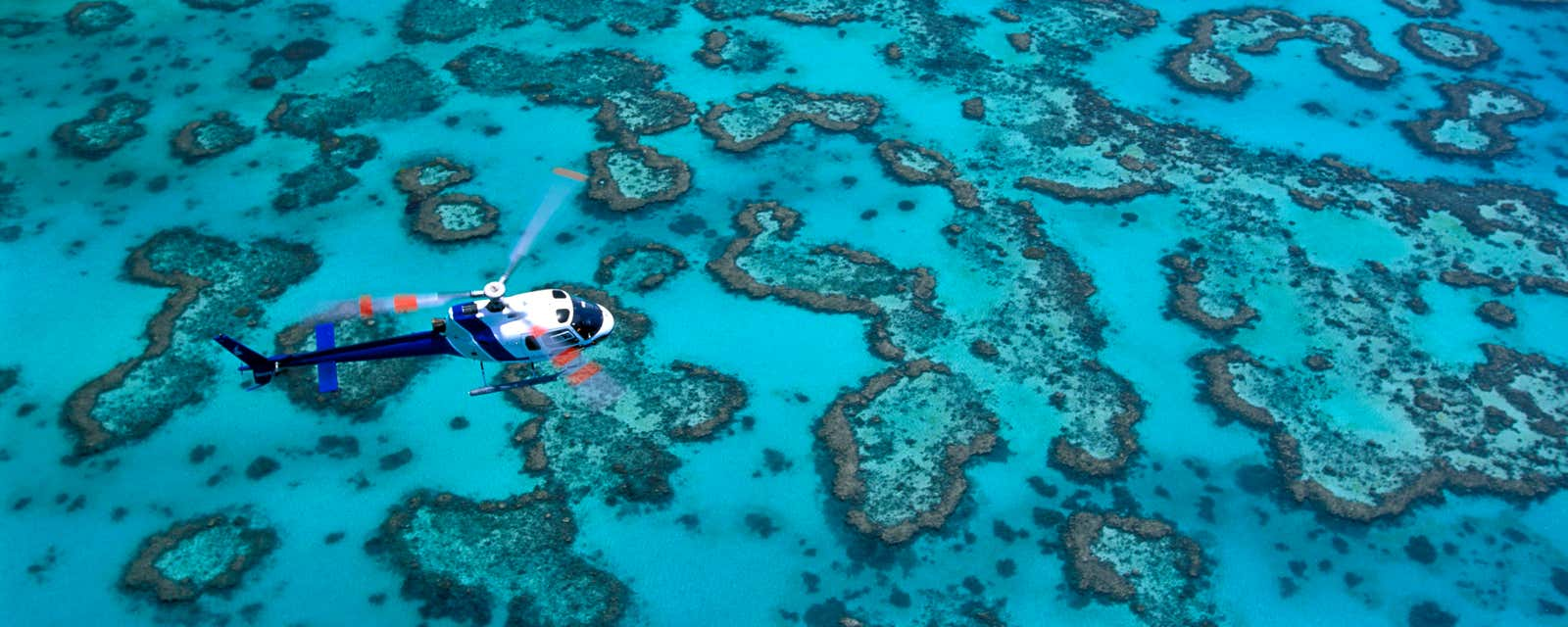 A helicopter hoveing over Heron Island, Great Barrier Reef, Australia.