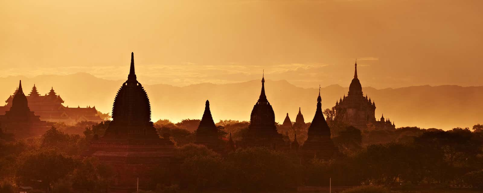 The pagodas of Bagan, Myanmar, silhouetted by the setting sun.