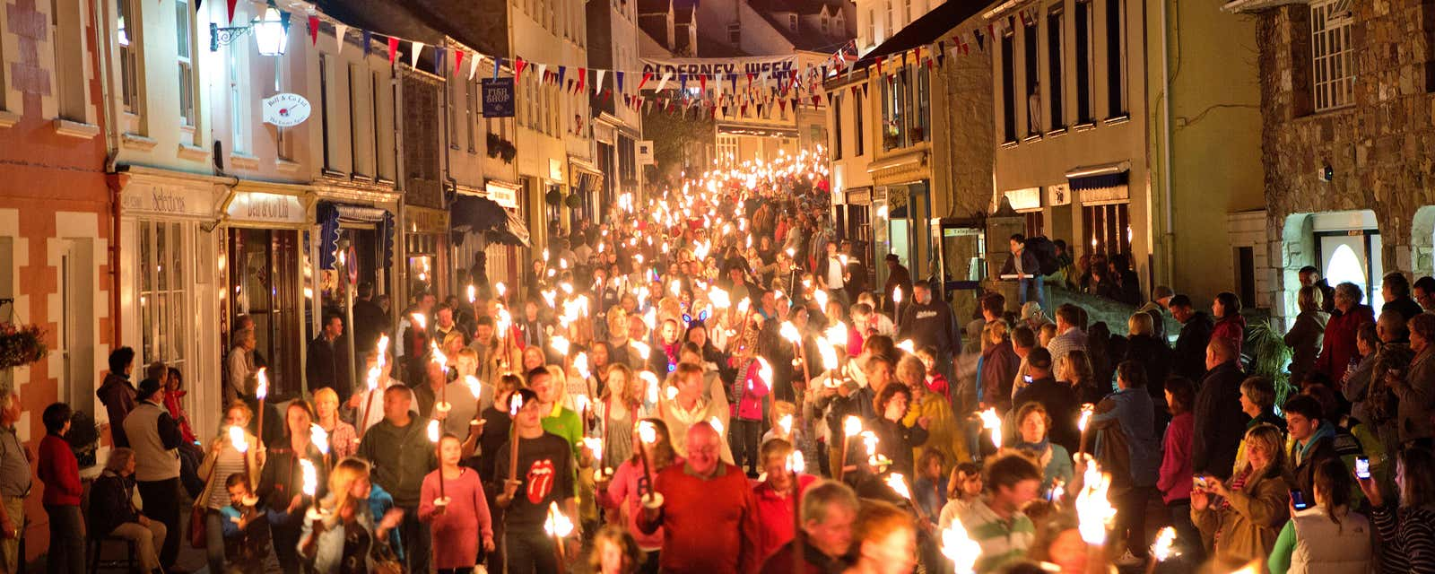 A torchlit procession through Alderney in the Channel Islands.