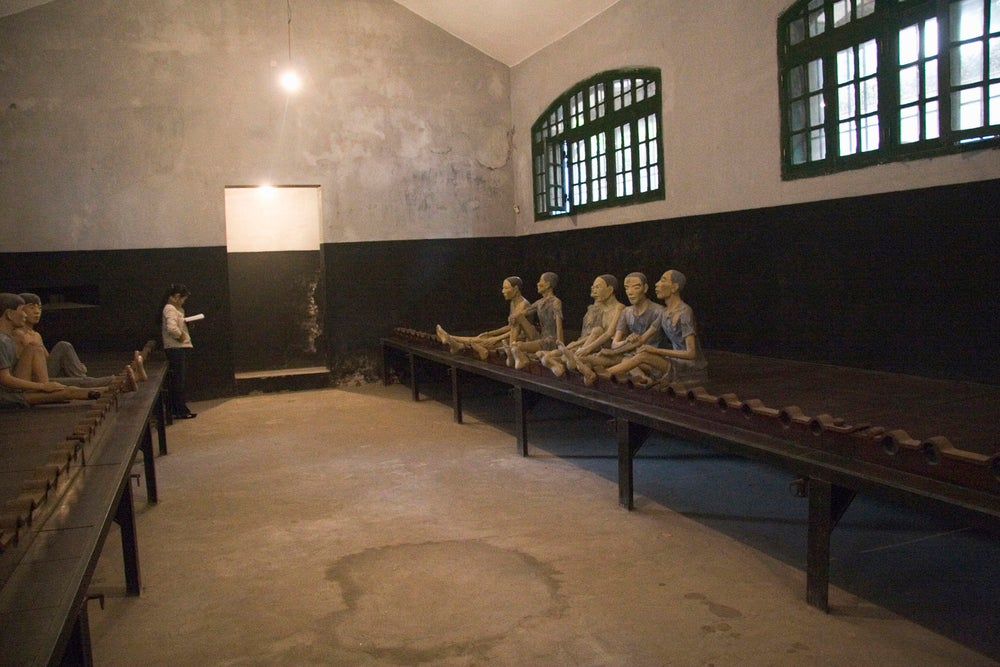 Models of prisoners at Hoa Lo Prison Museum.