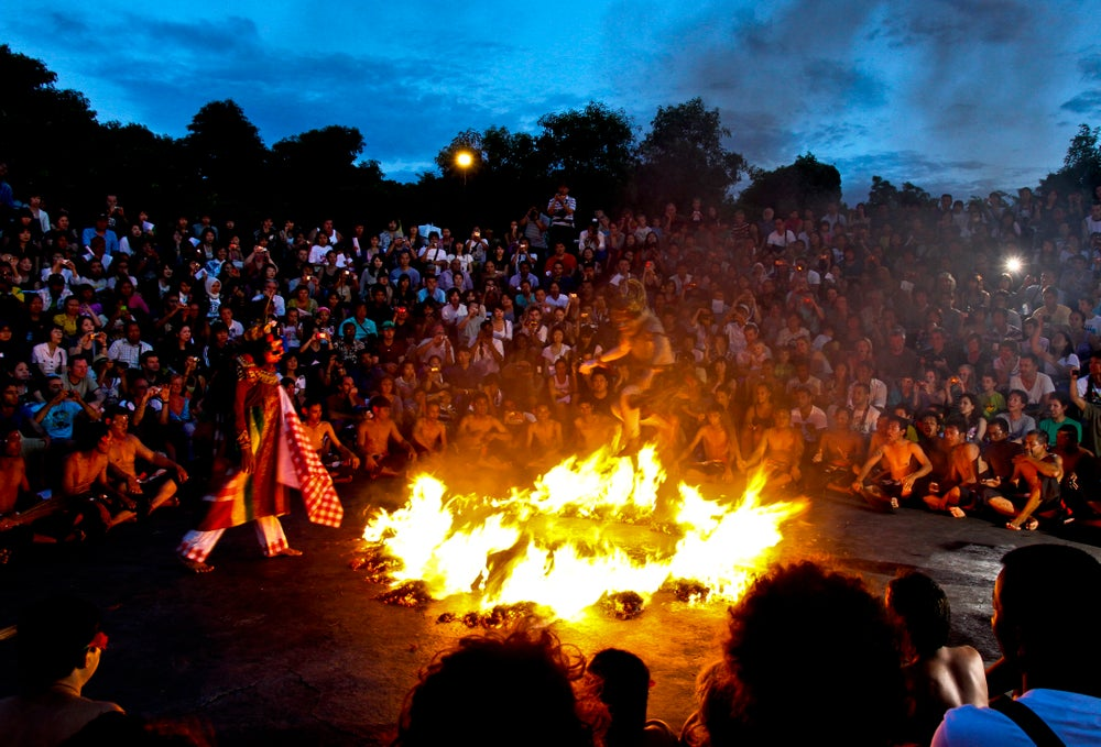 Kecak dance performance around a fire.