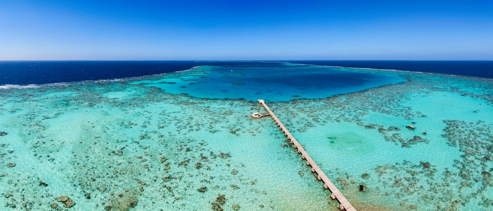 Jetty over coral reefs in Sanganeb National Park.