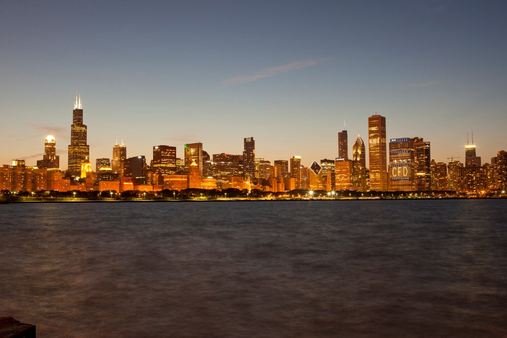 Chicago skyline at dusk seen from Northerly Island on Lake Michigan.