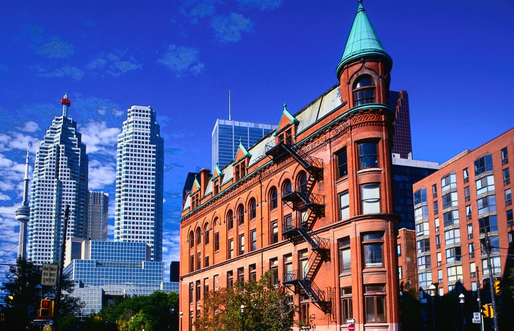 The Gooderham Building with CN Tower in background - Toronto