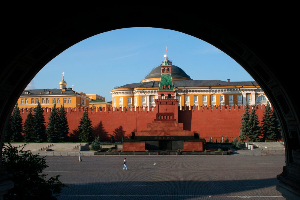 Lenin's Tomb framed by arch, from GUM department store.
