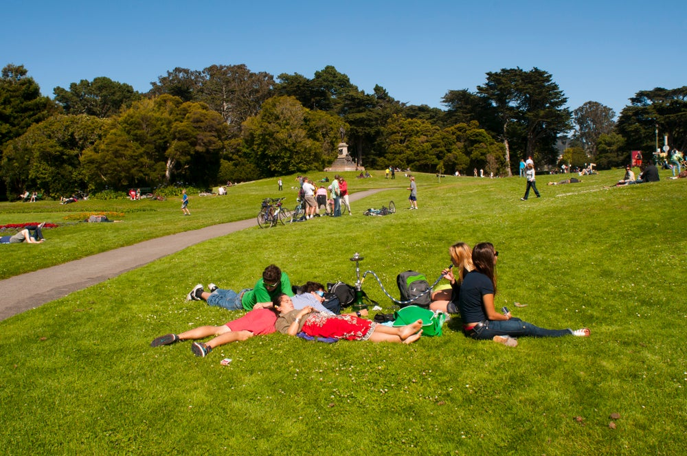 Young people relaxing in grass at Golden Gate Park.