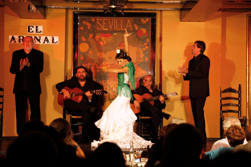 Maria Vargas Romero who's been a flamenco dancer for 25 years is performing at the tablao El Arenal, Seville, Andalucia, Spain.