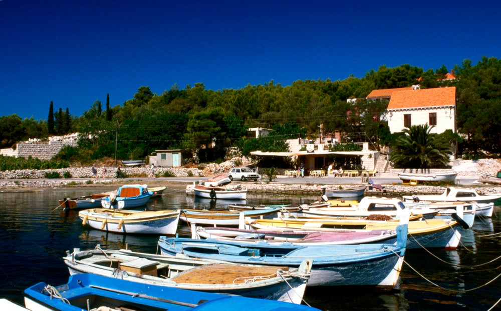 Fishing boats moored in the little harbour at Lumbarda, Southern Dalmatia.