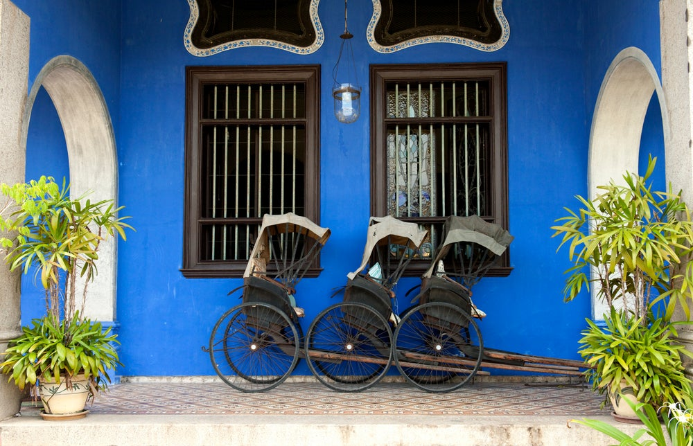 Vintage rickshaws outside Cheong Fatt Tze Mansion (Blue Mansion).