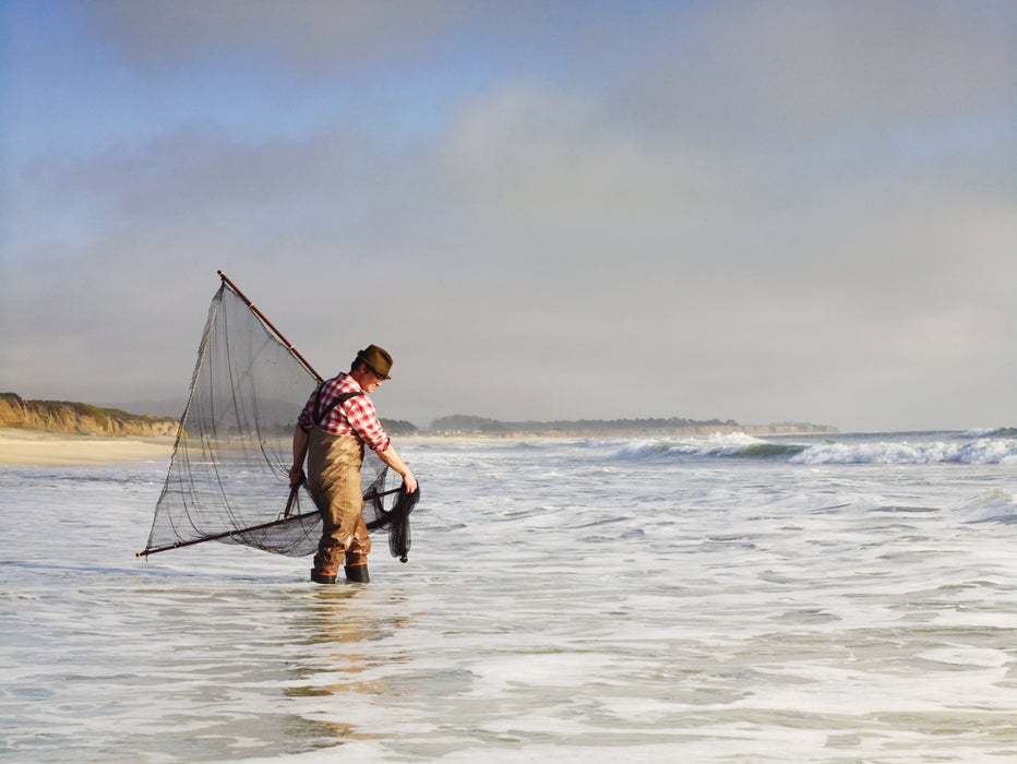 Sea forager Kirk Lombard scouring waters of Half Moon Bay for smelt.
