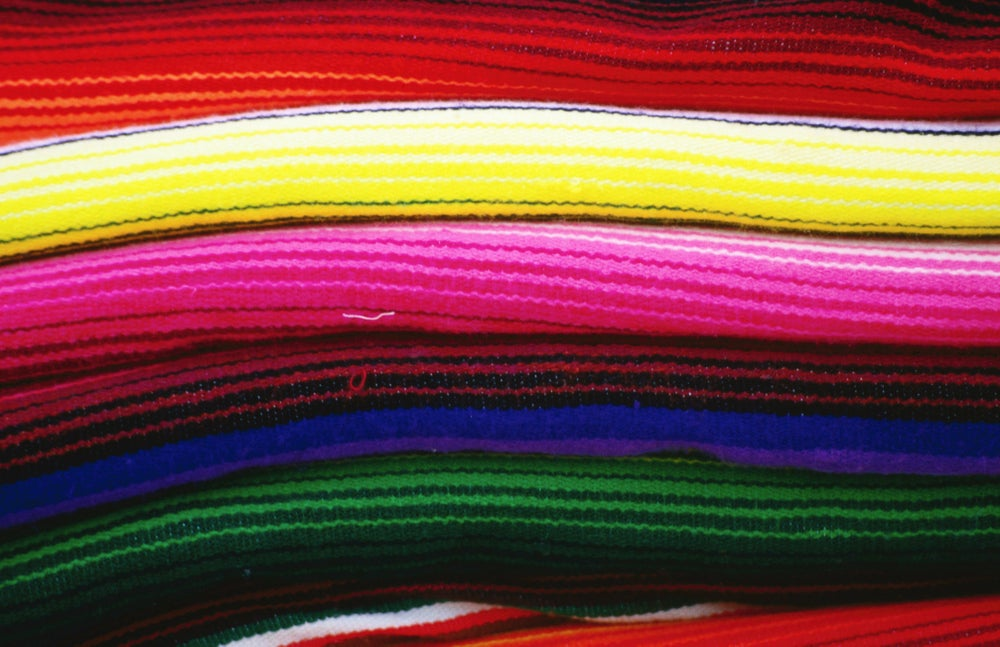 Colourful Mexican blankets for sale Valladolio.