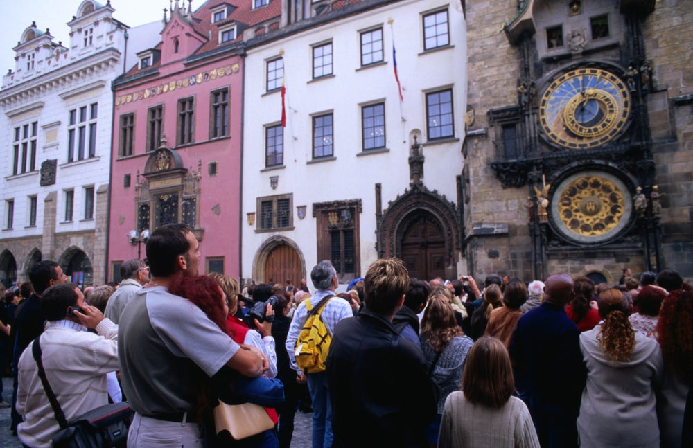 Tourists watching statues of the 12 apostles giving an hourly performance at Orloj (Old Town Hall).