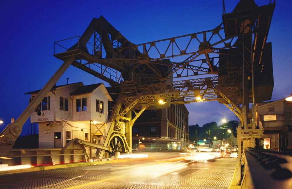 Mystic River Bascule Bridge, lit up at night.