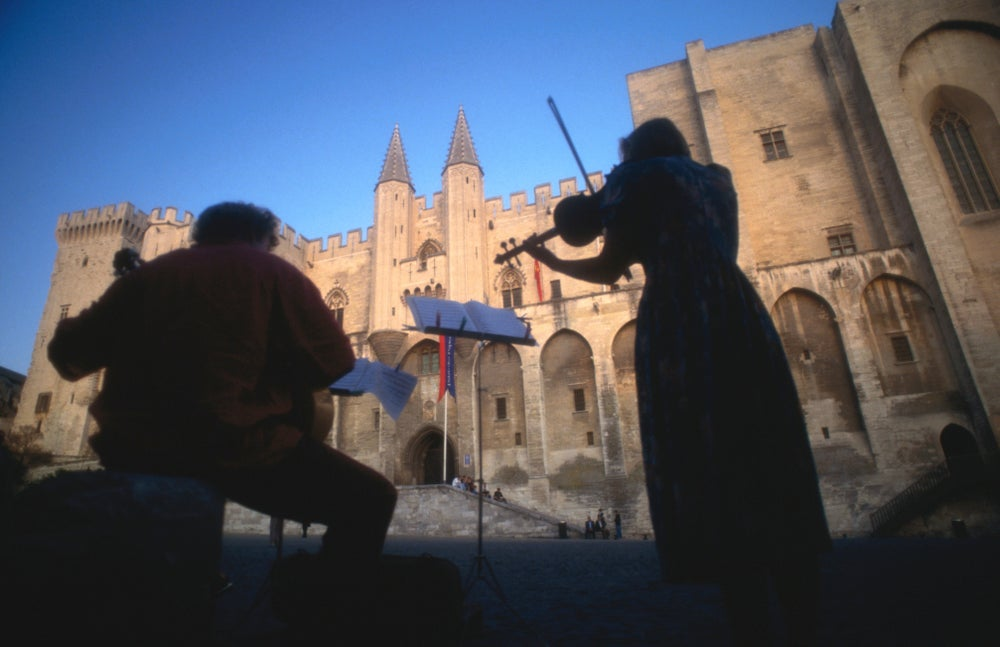 Musicians playing in front of Palais des Papes (Palace of the Popes), Vaucluse.