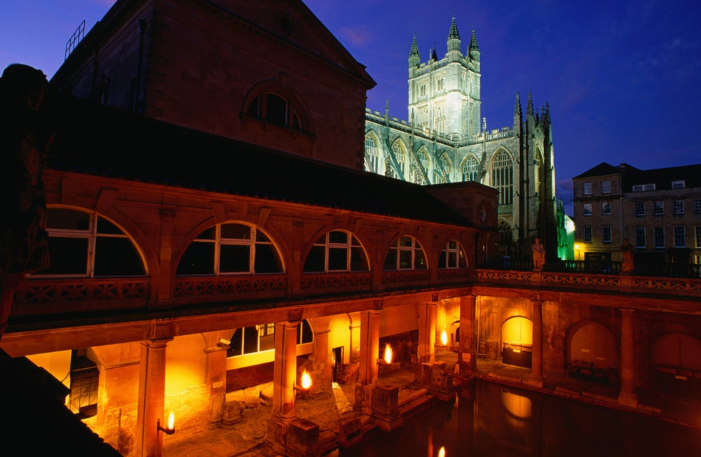 View into the Roman Baths Museum at night.