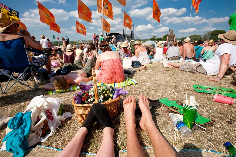 View of couple's feet at Glasonbury Festival.