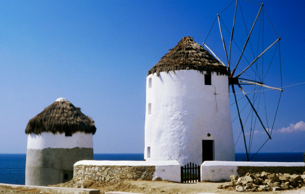 Windmills with thatched roofs.
