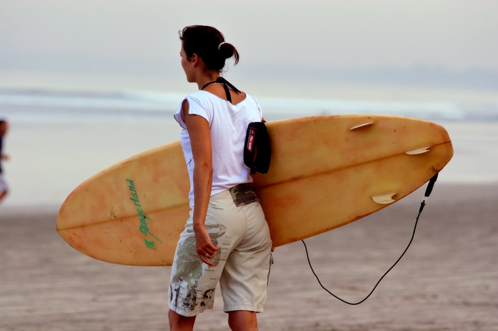 Girl with surfboard.