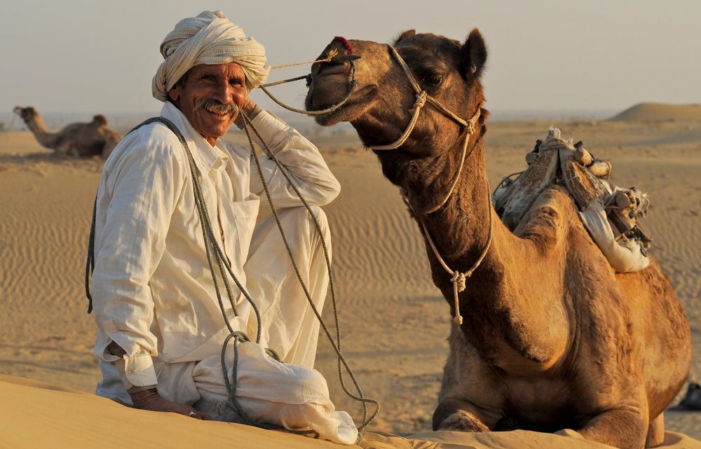 Portrait of man from Bishnoi Hindu sect with camel.
