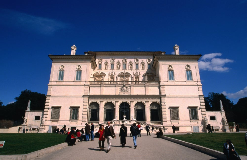Tourists wait in the gardens for entry to the Museo e Galleria Borghese in Rome.
