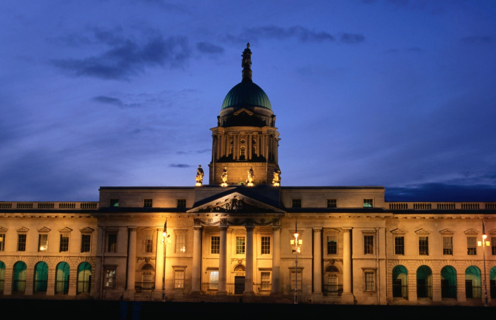 Exterior of Custom House at dusk.