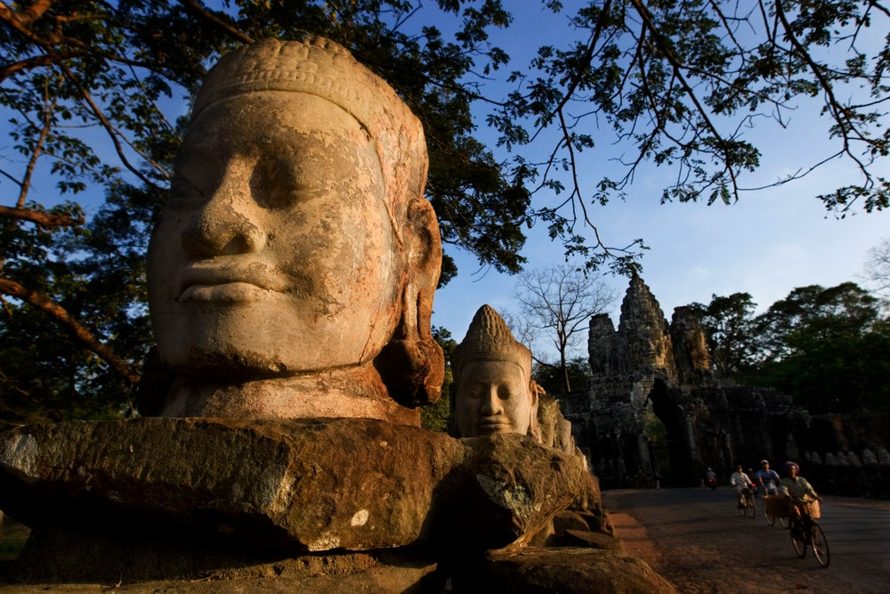Large head sculpture at South Gate of Angkor Thom.