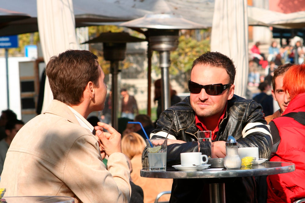 People sitting at outdoor cafe in Kavarna Plocnik.
