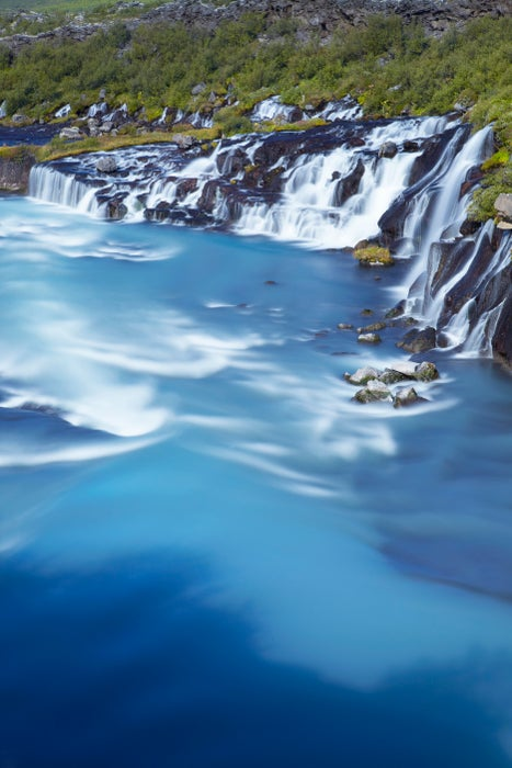 Hraunfossar waterfalls on volcanic rocks formed from lava flow, Borgarfjorour.