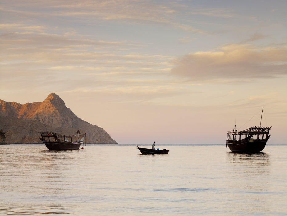 Fishing boats in water at dawn near Kumzar Village.