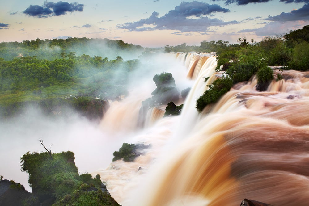 Water pouring over Iguazu Falls.
