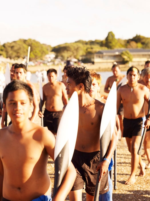 Schoolboys with canoe paddles on Waitangi Day.