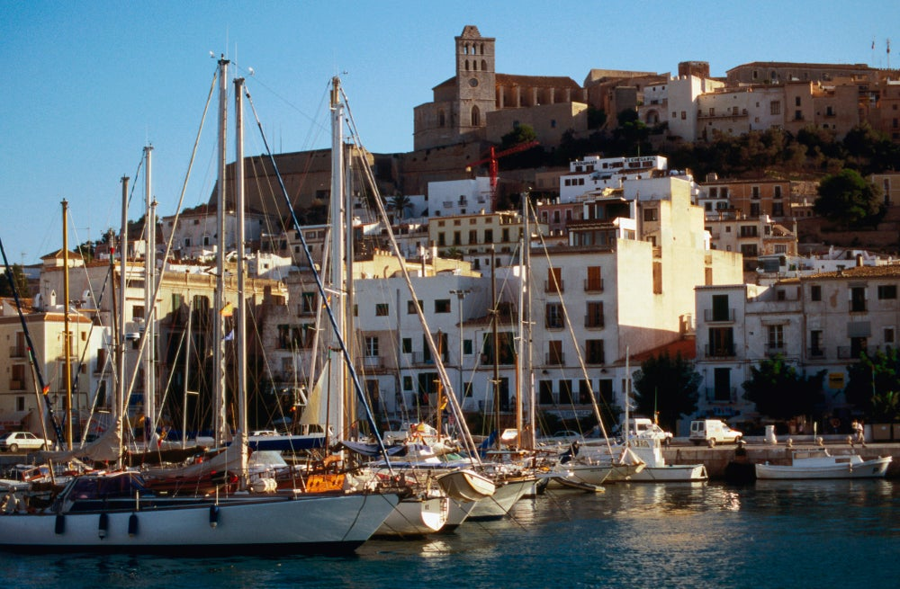 The harbour in Ibiza with D'Alt Vila, the fortress and walled town on the top of the hill.