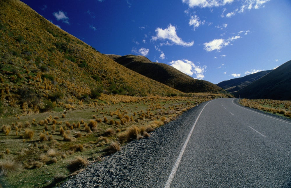The barren landscape of Lindis Pass, the shortest route between Christchurch and Queenstown.