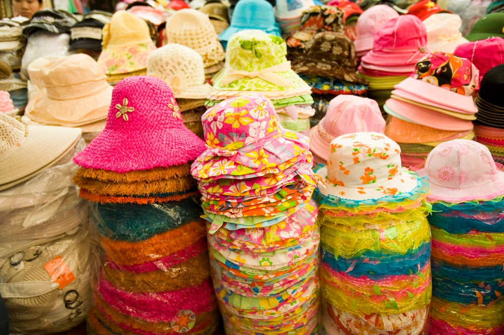 Towers of hats for sale at Dong Xuan Market, Old Quarter.