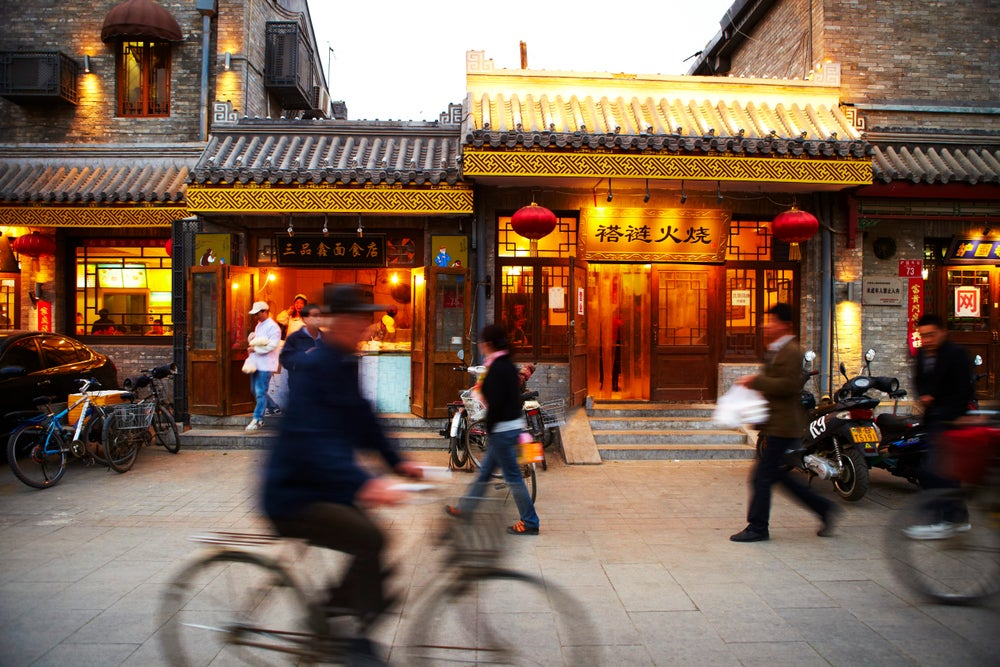 Imperial shopfronts in traditional hutong district.