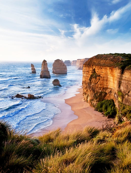 Twelve Apostles limestone stacks along rugged coastline.