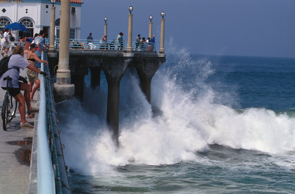 Storm generated surf surging against Manhattan Beach pier.