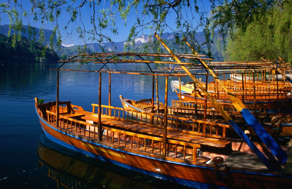 Gondolas, known locally as pletna, on the shores of Lake Bled. These pletna ferry passengers to Bled Island, which sits in the middle of the lake.
