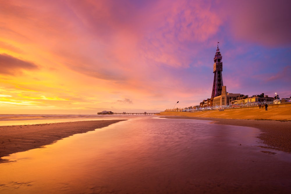 Blackpool Tower seen from the beach at sunset.