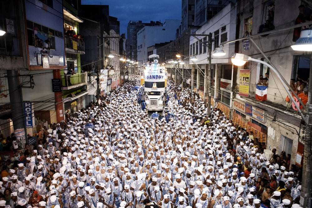 Parade of the Filhos de Gandhy carpeting the city in blue and white.