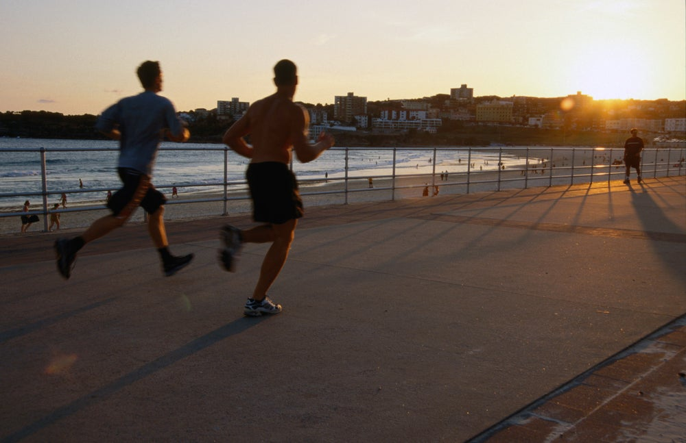 Joggers on promenade at Bondi Beach.