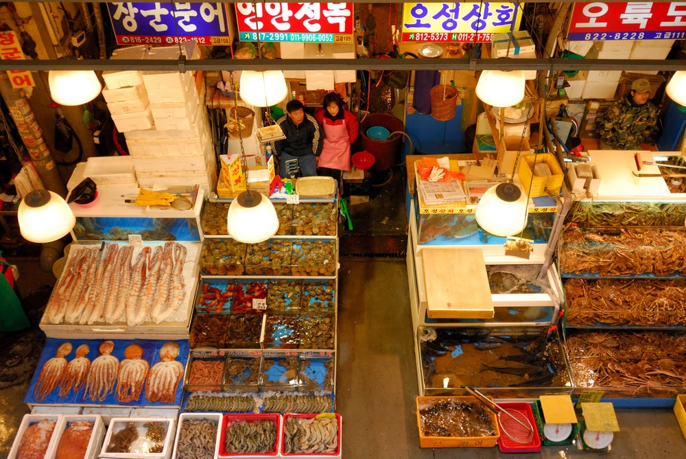 Overhead of Noryangjin Fish Market selling Octopus, crabs,various seafood, Sinchon.