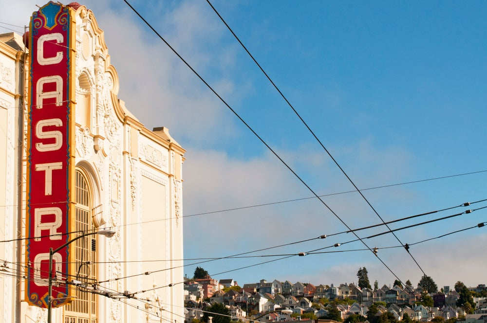 Castro theater, overhead wires and houses.