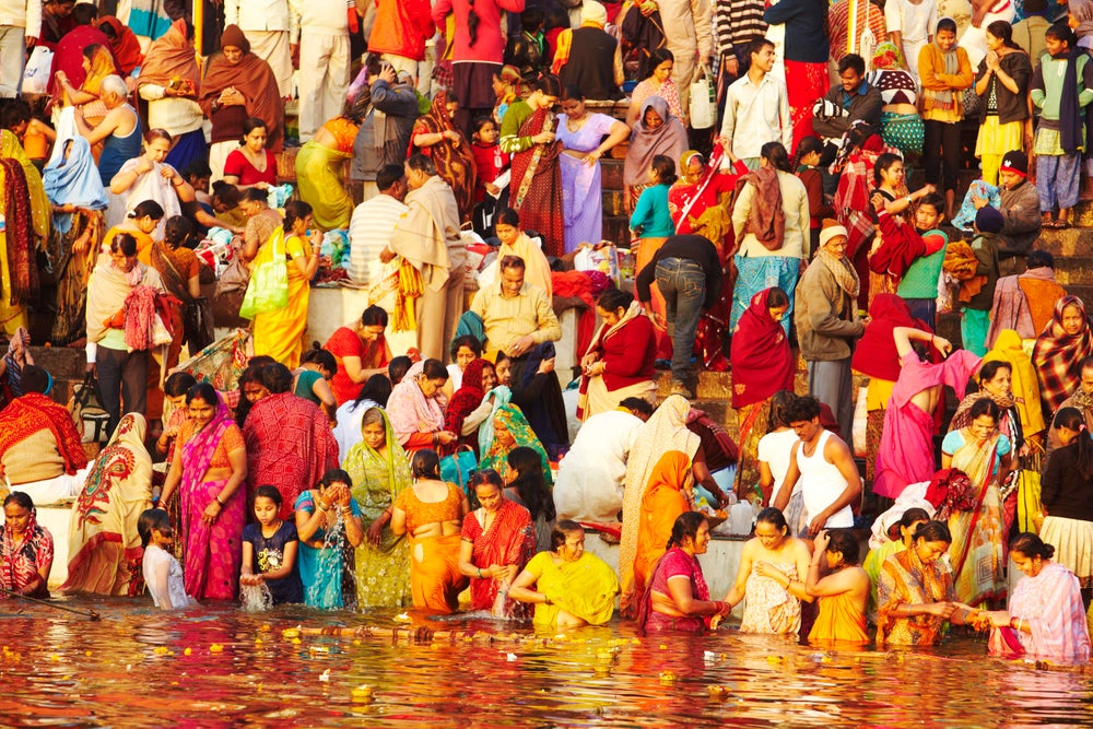 Crowd of people bathing in the Ganges.