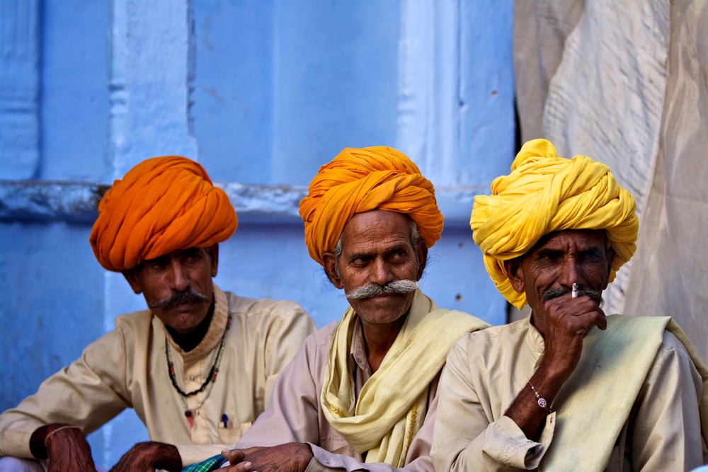 Three men in turbans at Pushkar Camel Fair.