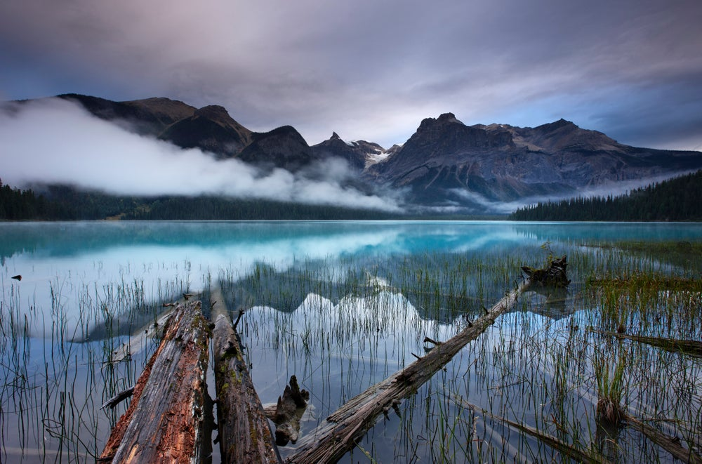 Emerald Lake at dawn with peaks of President Range beyond.