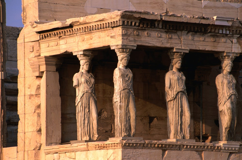 Erechteion Temple and the southern porch held up by six Caryatids at the Acropolis.