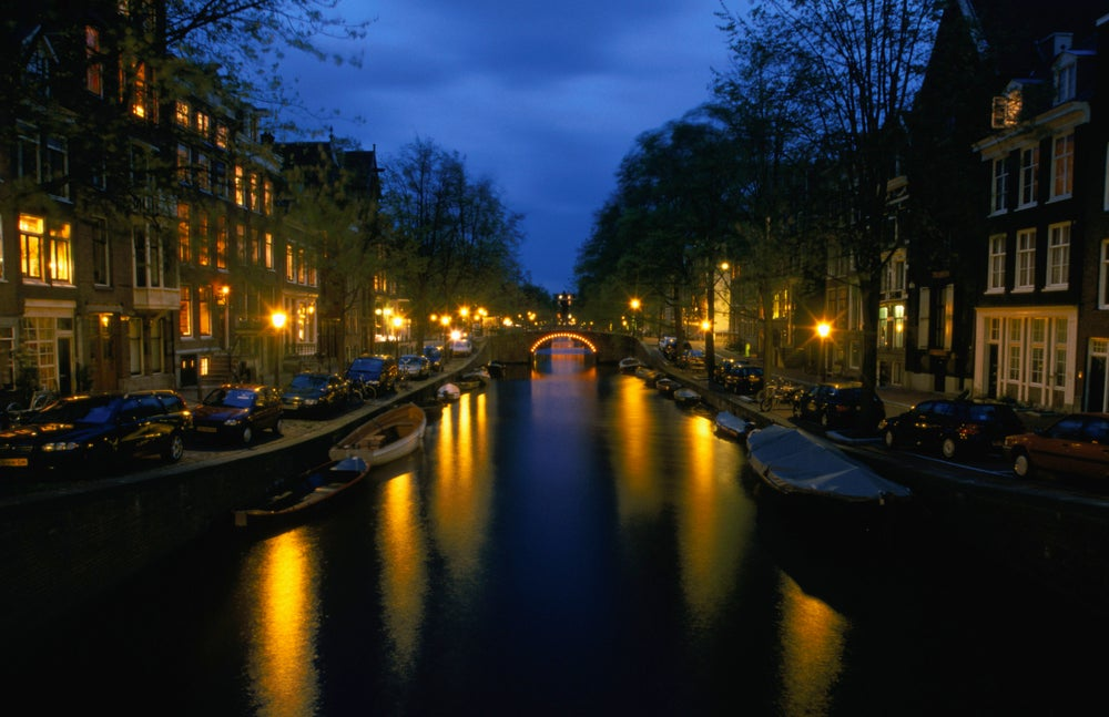 Illuminated bridges and gabled houses in the evening light (Reguliersgracht), Southern Canal belt.
