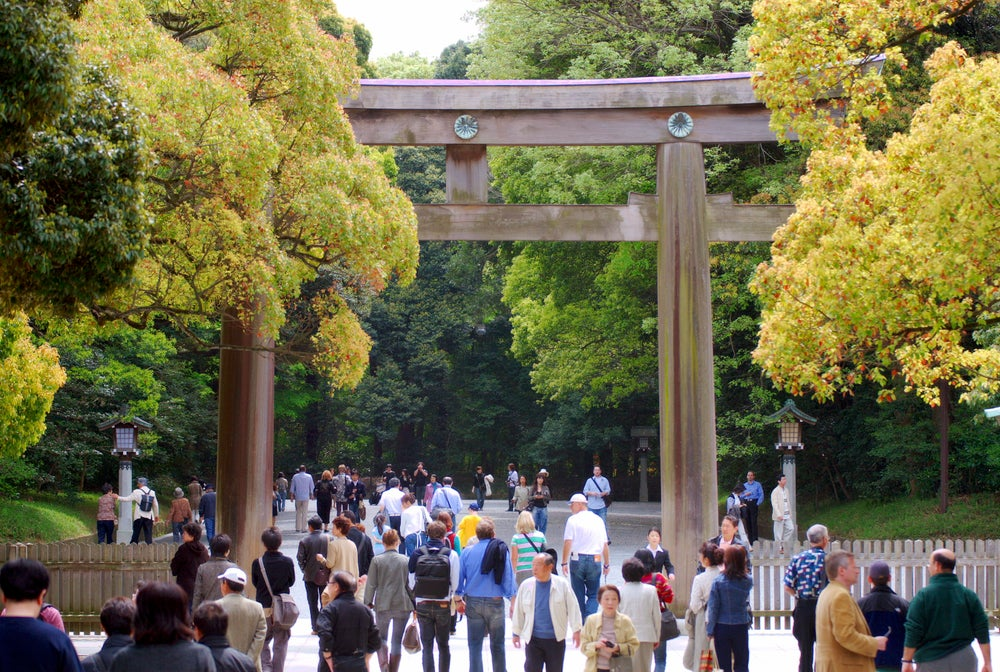People passing through traditional gate (torri), Meiji-jingu, Harajuku.